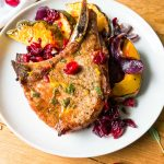 Acorn squash and pork chop sheet pan dinner with cranberries and a sage honey vinaigrette. Gluten and dairy free, paleo Wahls protocol 30 minute one pot easy weeknight dinner.