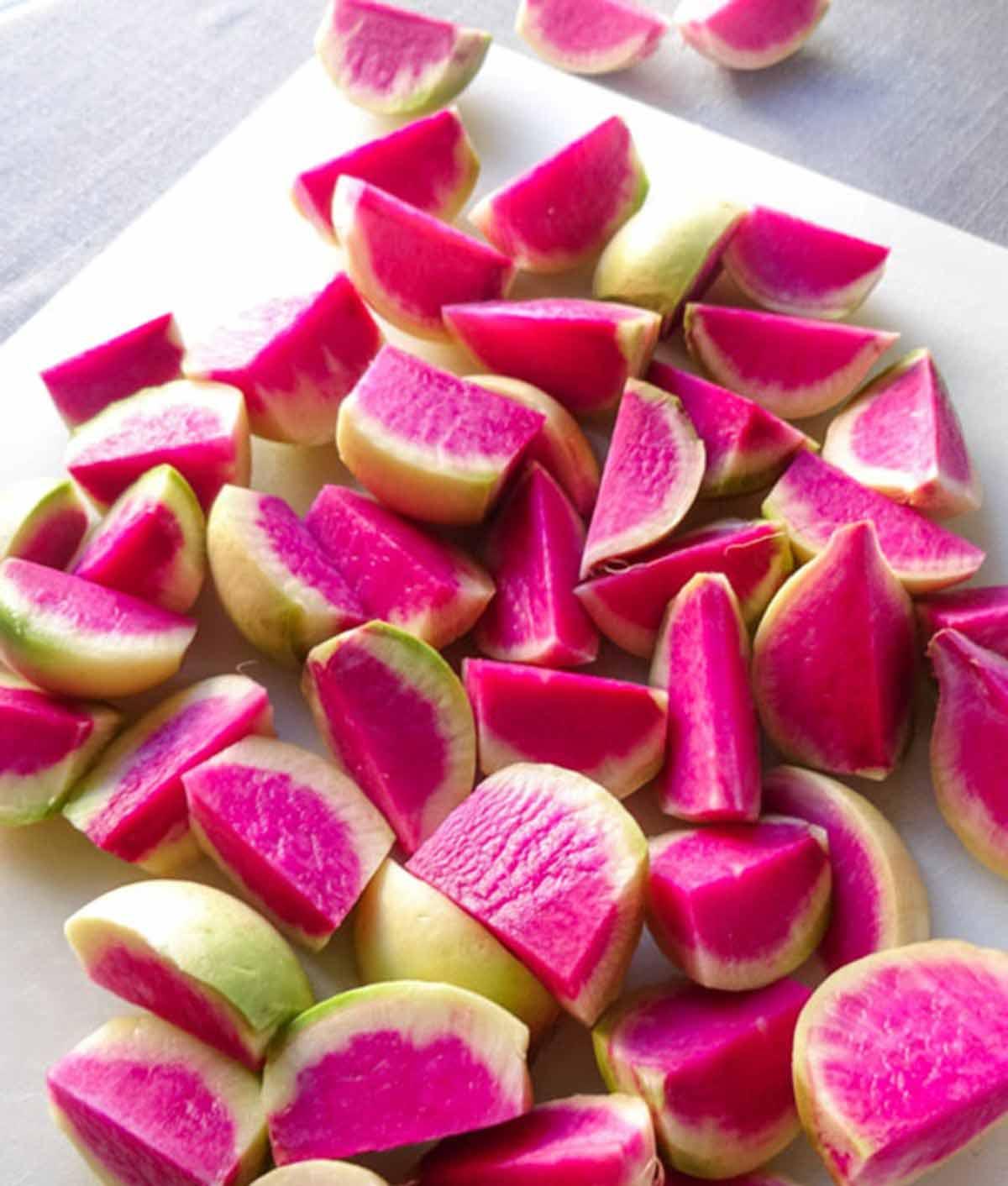 raw watermelon radishes on cutting board