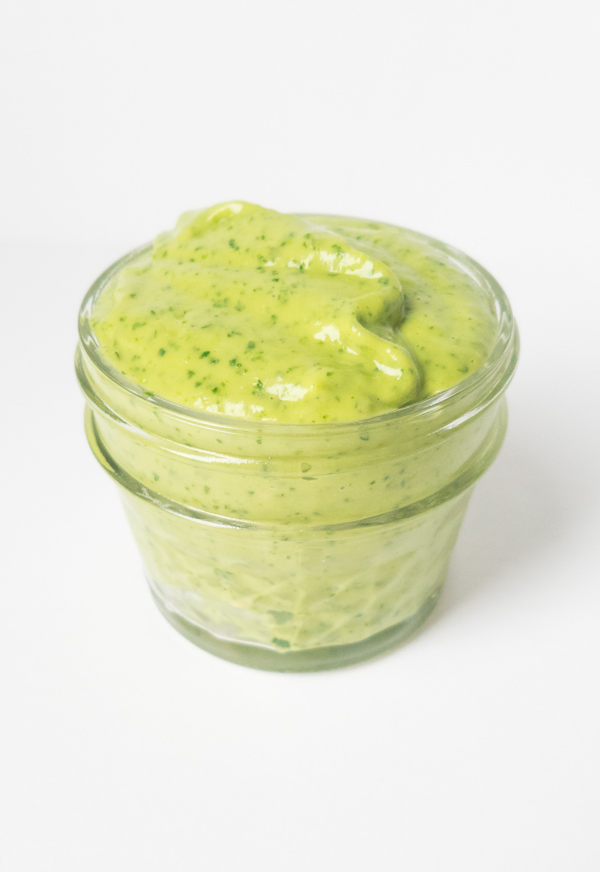 Four-Ingredient Avocado Sauce does double duty as a sandwich spread, sauce for your favorite veggies or meat, you can even thin it out to use as a salad dressing. Make ahead, less than 5 minutes to make and is AIP compliant, paleo, vegan, nut, egg, gluten and dairy free. We love how easy and versatile this sauce is! Peelwithzeal.com