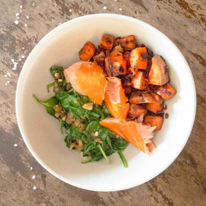 smoked salmon spinach and sweet potatoes in a bowl