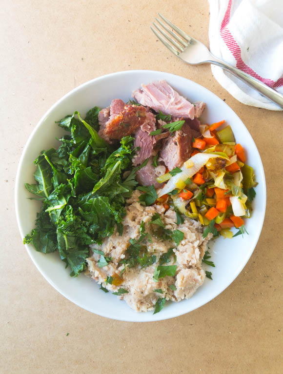 This fresh and filling lunch bowl uses your Easter leftovers for an easy Monday meal. Feature simple greens, mashed white beans, spring veggies and your leftover ham.
