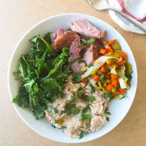 lunch bowl leftover easter ham, mashed white beans and spring veggies