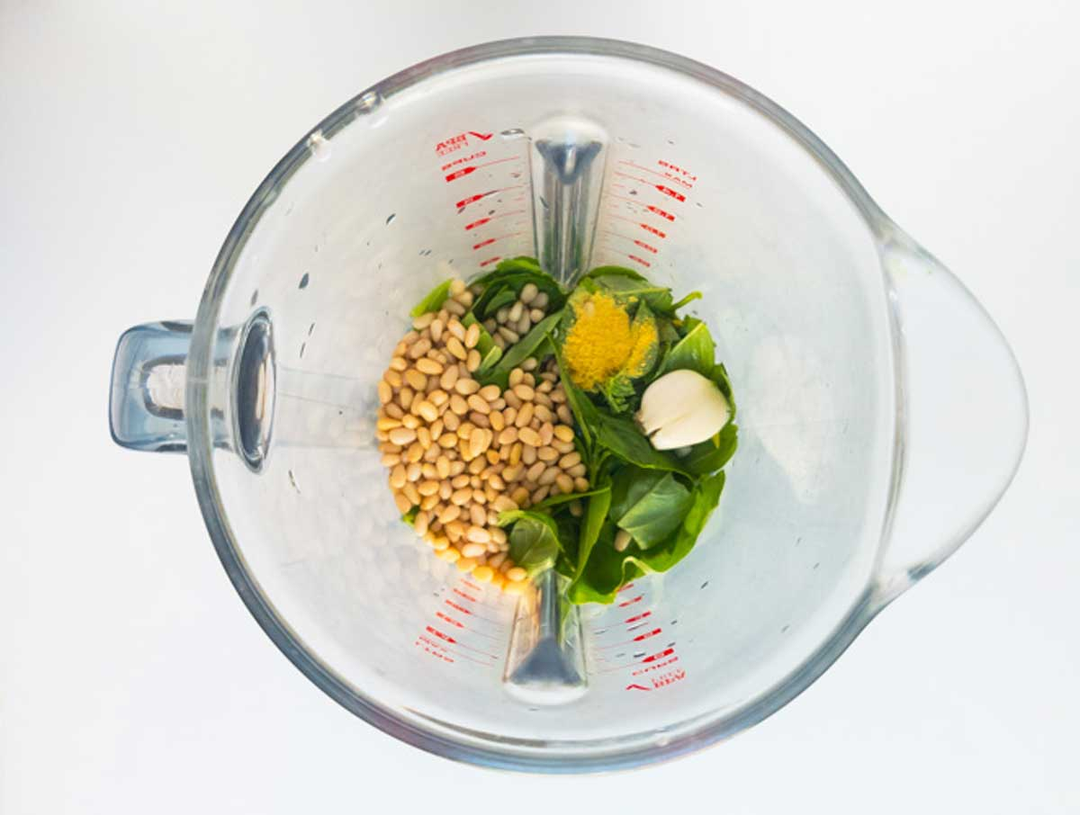 basil pesto ingredients in a blender