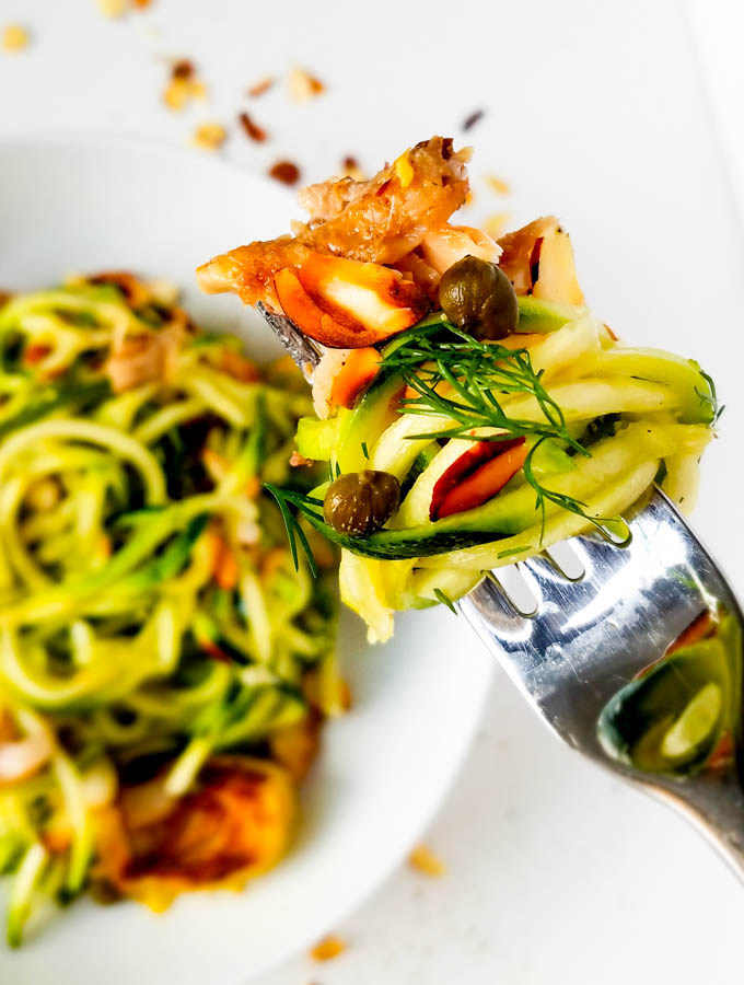 Mediterranean summer pasta with zoodles is our perfect quick, one pan low-carb version of pasta de sardina. Lemony artichokes with herbs, sardines and zucchini noodles. Peelwithzeal.com #glutenfree #summerrecipe #sardinerecipe #onepot #zoodles #zucchininoodles #30minuterecipe #fast #easy #quick #dinner #weekendlunch #wahlsprotocol