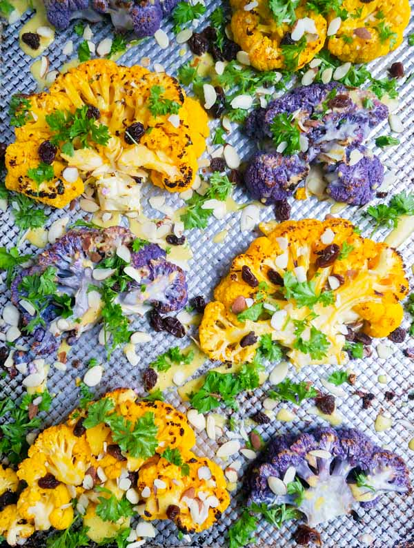 Breakout the grill for this vegetarian steak alternative. Colorful cauliflower steaks and a flavorful curry dressing is as easy to make as it is good for you! #glutenfree #dairyfree #paleo #whole30 #wahls #recipe #onepot #dinner