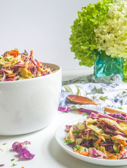 Spicy avocado coleslaw is great for your next potluck. Full of rainbow veggies and it has a vegan option. This easy make ahead recipe is perfect for summer. Plus it is Whole3, paleo, and wahls protocol compliant. #coleslaw #spicyrecipes #veggies #cabbage #avocado #paleo peelwithzeal.com