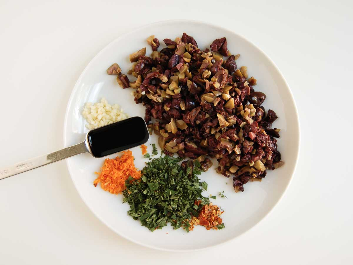 olive tapenade ingredients on a plant