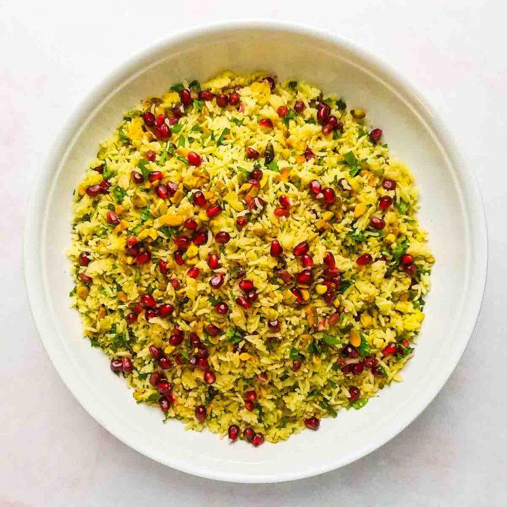 saffron rice recipe in white bowl