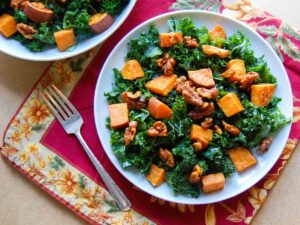 roasted sweet potato and kale salad on a white plate