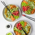 vegan poke bowl recipe on grey plate on white table with black chopsticks