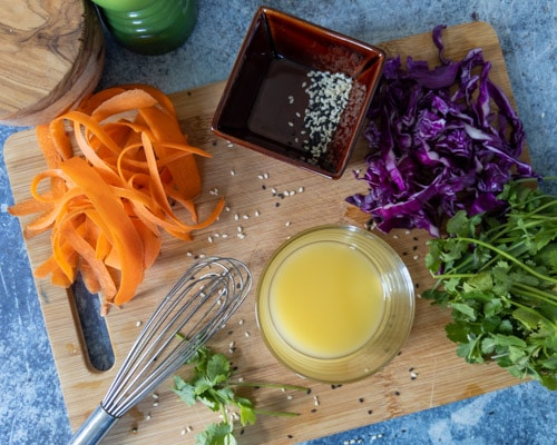 ingredients for sesame shrimp salad on cutting board