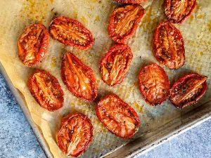 romasted roma tomatoes on baking sheet