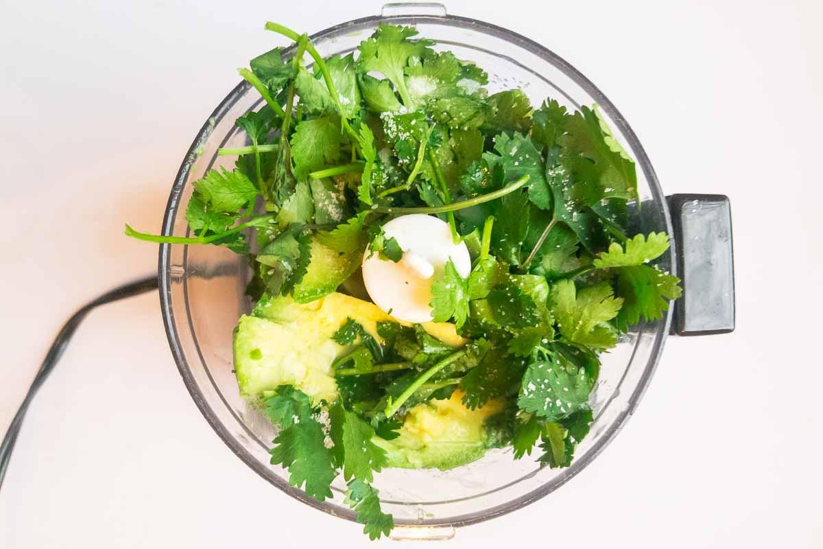 avocado sauce ingredients in a blender