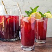 blueberry iced tea in glasses with pitcher