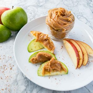 cashew butter recipe in a jar with apples