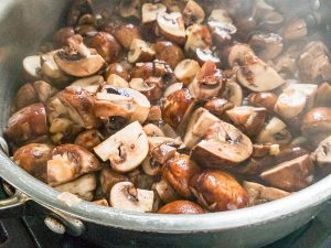 saute mushrooms in a pan