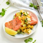 Salmon with pineapple relish on plate