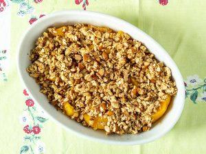 gluten free peach crumble in a bowl