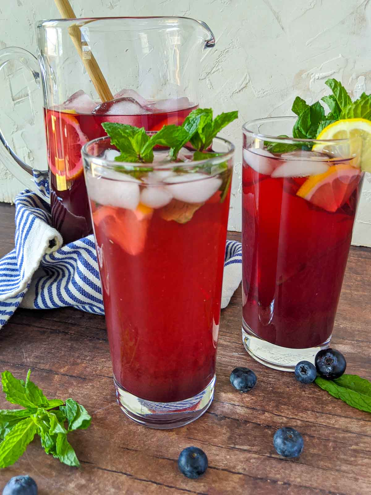 blueberry tea in glasses with lemon and mint