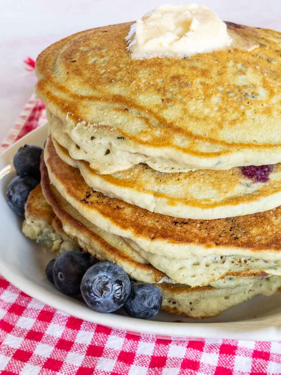 gluten free pancakes with butter on plate