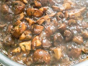 chestnut mushrooms cooking in wine