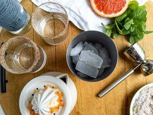preparing a mezcal cocktail recipe