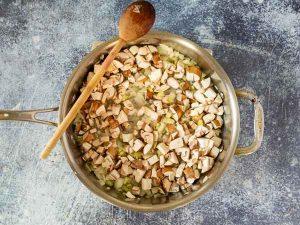 saute mushrooms in pan for tuna noodle casserole