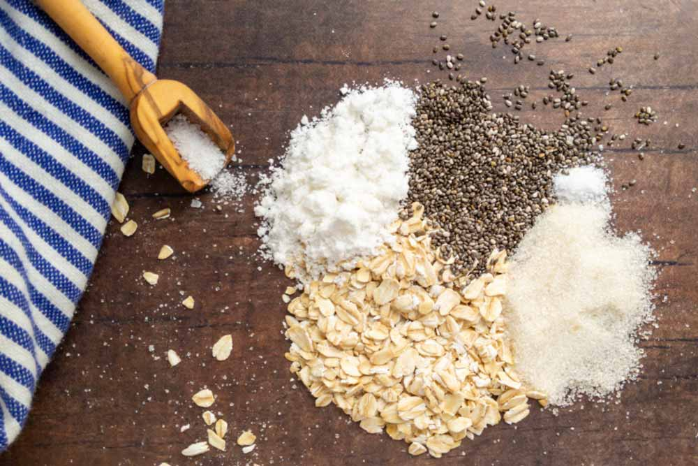 overnight oat recipe ingredients on wood table