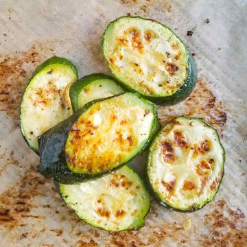 roasted zucchini on parchment paper