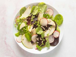 beet and watercress salad on a plate