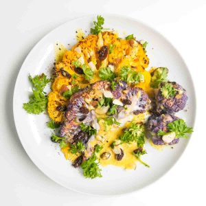 curried cauliflower steak recipe on a plate