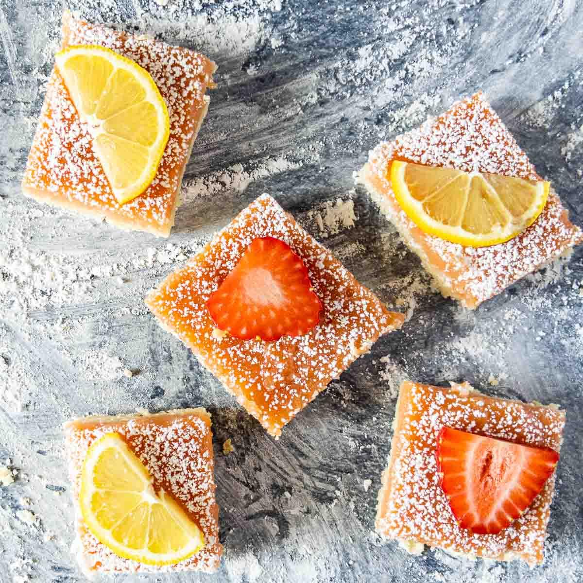 five lemon bars on counter