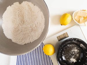 measuring out dry ingredients for lemon bars