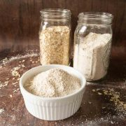 whole oats and oat flour in jars
