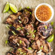 lemongrass grilled pork on a tray with dipping sauce