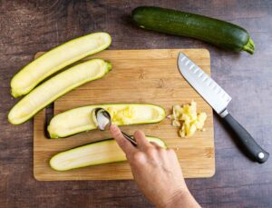 hollowing out zucchini with a spoon