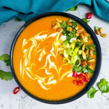 thai pumpkin soup in a black bowl