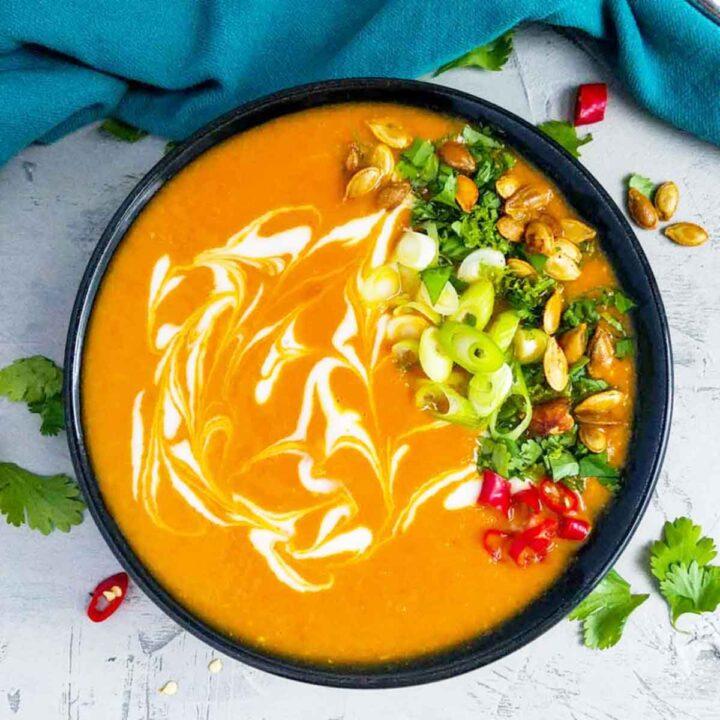 thai pumpkin soup in a black bowl