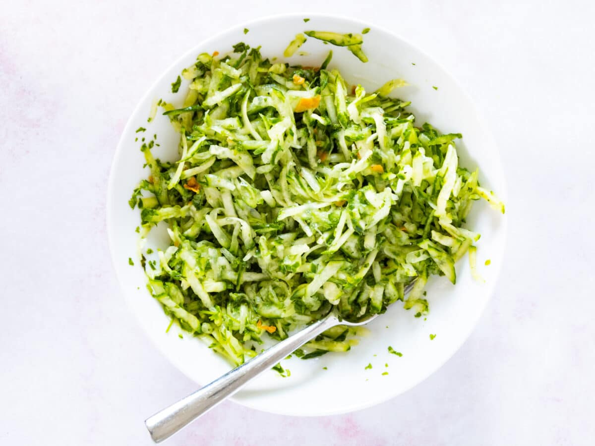 cucumber chutney being mixed in bowl