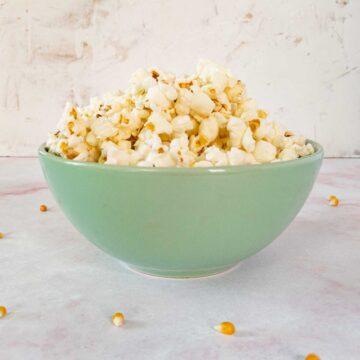 duck fat popcorn in a green bowl