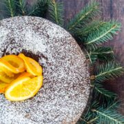 gluten free spice cake decorated with candied oranges