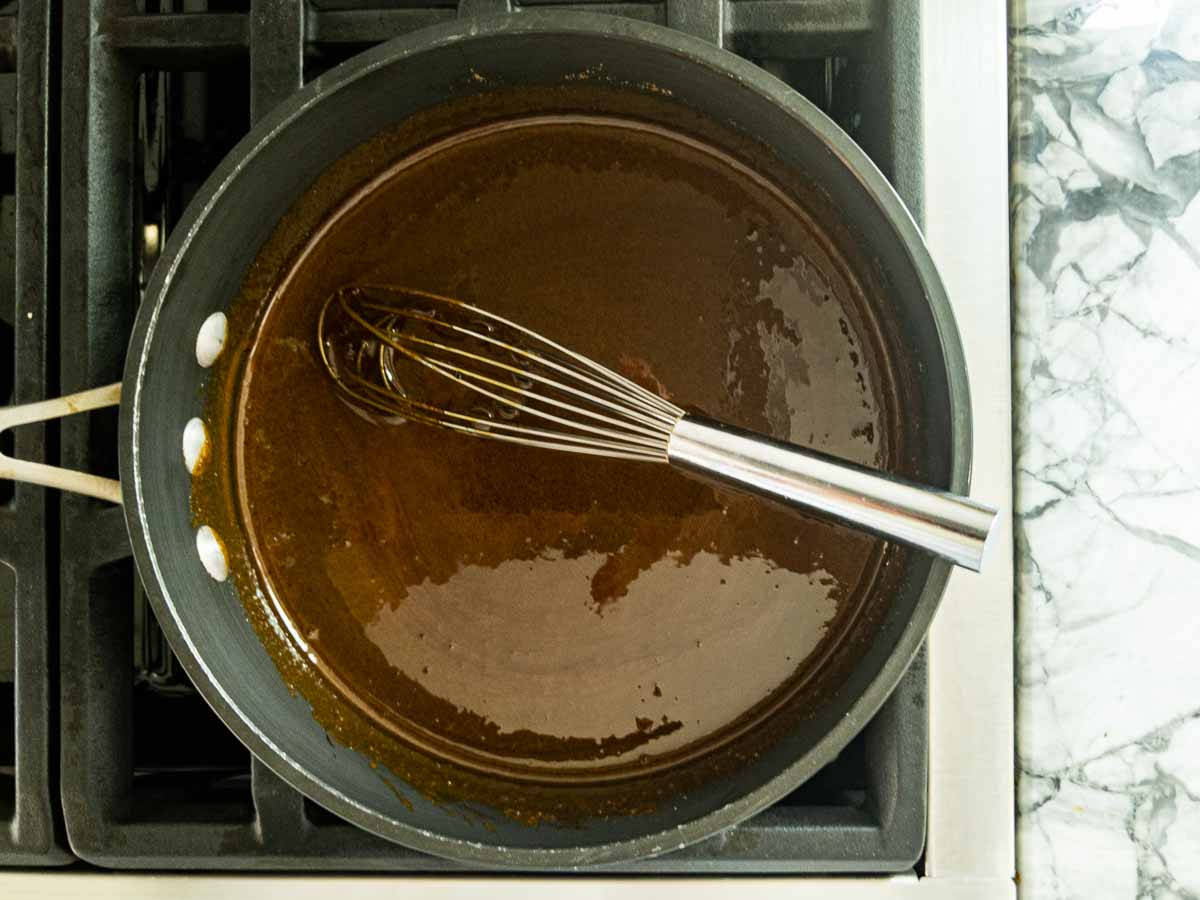 melted molasses and sugar in pot