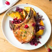 pork chop and acorn squash on dinner plate