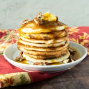 stack of pancakes with pumpkin syrup
