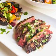 seasoned grilled flank steak on plate