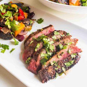 seasoned grilled flank steak on plate
