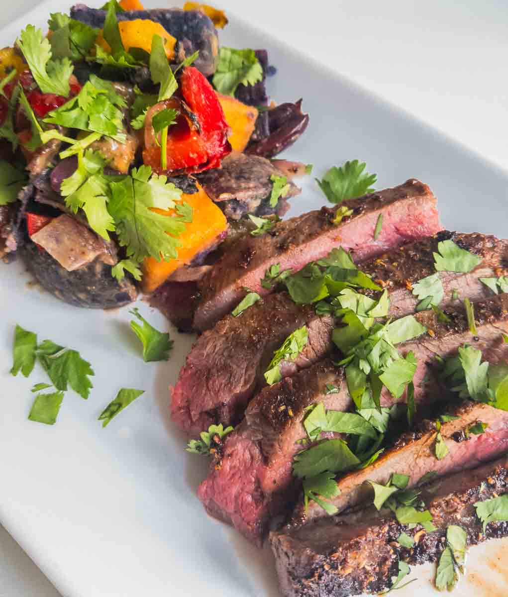 spice crusted flank steak on plate