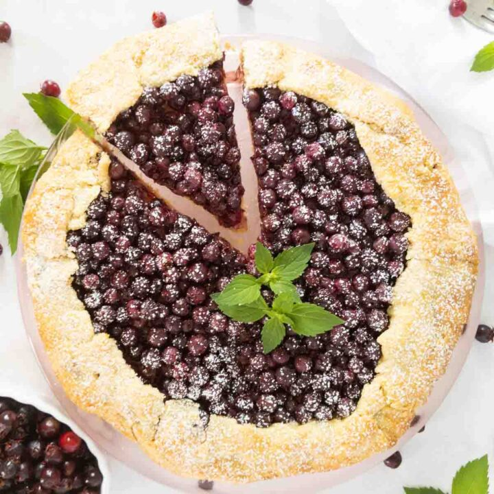 serviceberry galette with a grain free crust with slice being removed