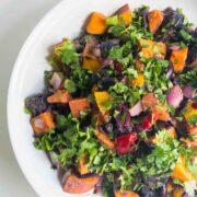 rainbow potato salad in a serving bowl