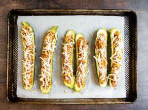 zucchini boats on sheet before baking